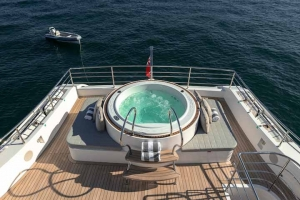 Expansive rear deck with luxurious daybeds and jacuzzi