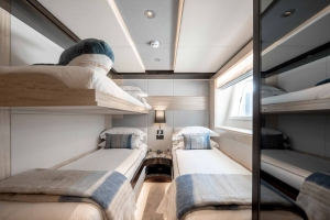 Two twin rooms with foldable loft beds, Oneworld sleeps up to 12 guests